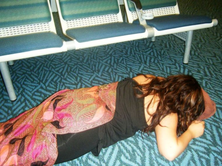 trying to sleep on the airport floor. i'll do what i have to do for my sleep!