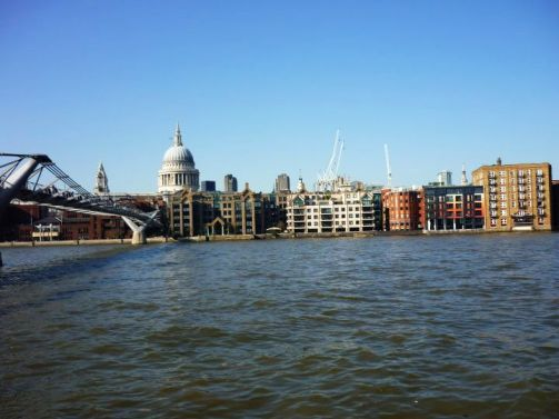 River Thames. Millenium Bridge to the left with St. Paul's Cathedral in the background.
