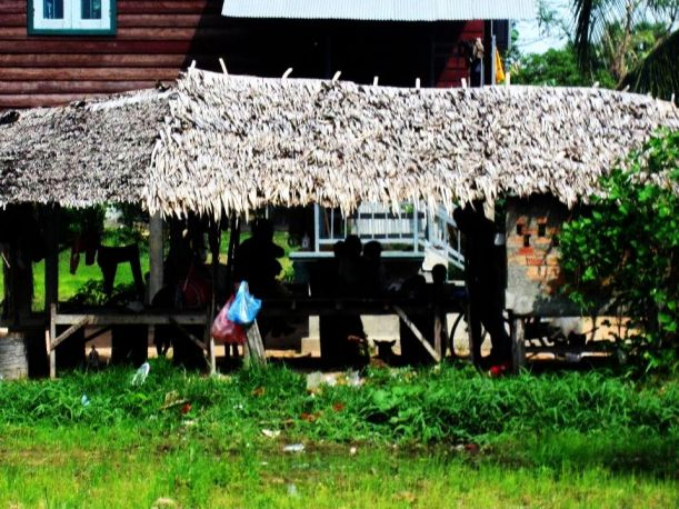 Cambodians lounging at their countryside home